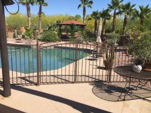 Bronze wrought iron pool gate enhances pool safety.